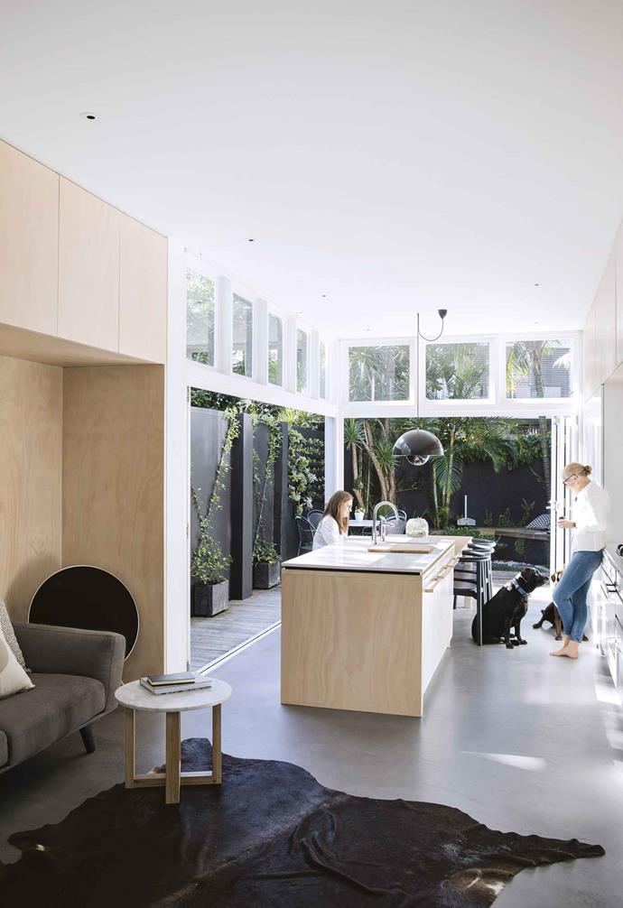 """In 2006, the family moved again, renovating a four-bedroom home on a steep block in the northern suburb of Cheltenham. They loved the area's high schools, but in 2010, as their children, Maddison and Oliver, were about to finish school, Sarah and Andrew noticed their former Paddington rental was up for sale and went to the open house. """"It was a tiny terrace and nowhere near suitable for our family,"""" she says.<br><br>**Kitchen** Sarah relaxes with daughter Maddison and dogs Charlotte and Milo. In a corner of the adjoining living area is a round [Bang & Olufsen](https://www.bang-olufsen.com/en