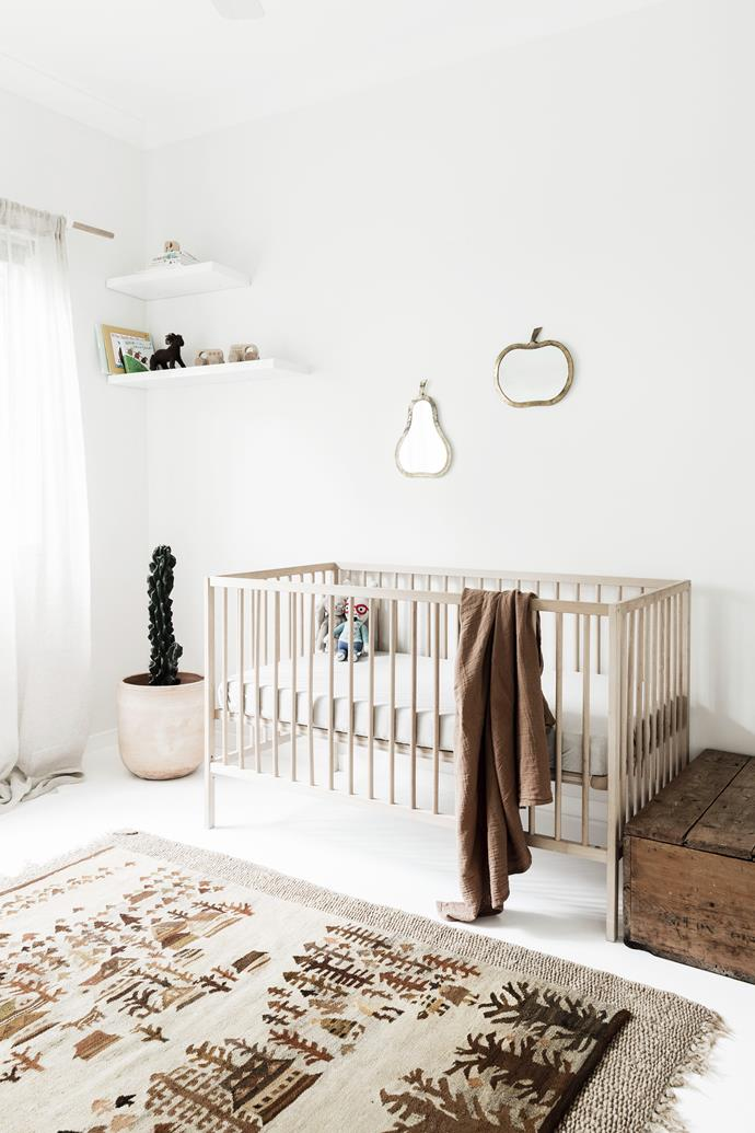 The decor in this nursery is kept simple and considered to create a serene, clutter-free space.
