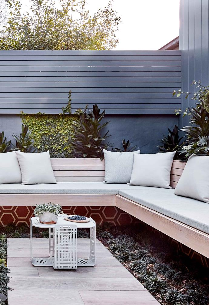 Landscape designer Adam Robinson rezoned this garden and made the L-shaped built-in seat its centrepiece.