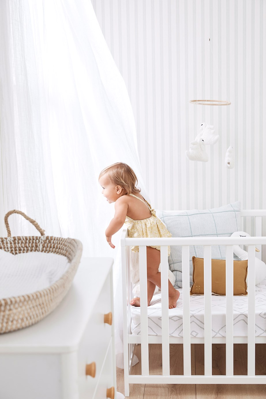 Cover your basics first - cot, change table, storage - and add decorative touches over time.