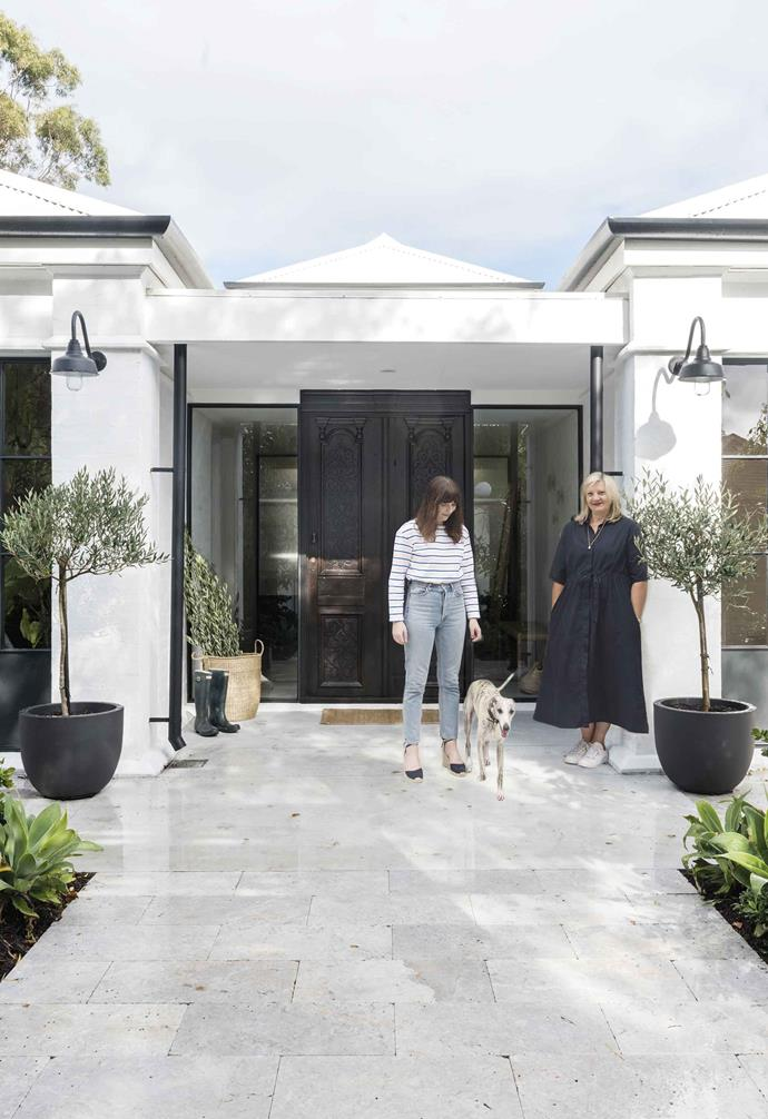 **Facade** Sue and daughter Georgia with Paul at the entrance. An oversized front door and contrasting wall lights and plant pots give the marble-tiled porch a sense of arrival.