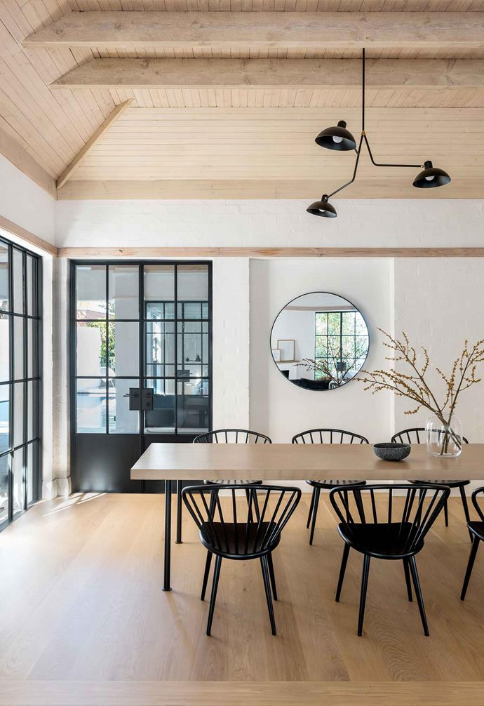 """**Dining** Timber on the floor, ceiling and table in between makes gives the home a cosiness it lacked before the renovation. Papillon table and Stolab 'Miss Holly chairs, [Thonet](http://thonet.com.au/ target=""""_blank"""" rel=""""nofollow""""). Mirror, [Empire Homewares](https://empirehomewares.com.au/ target=""""_blank"""" rel=""""nofollow""""). Bowl, [Asbury Park Agency](http://www.asburyparkagency.com.au/ target=""""_blank"""" rel=""""nofollow"""")."""
