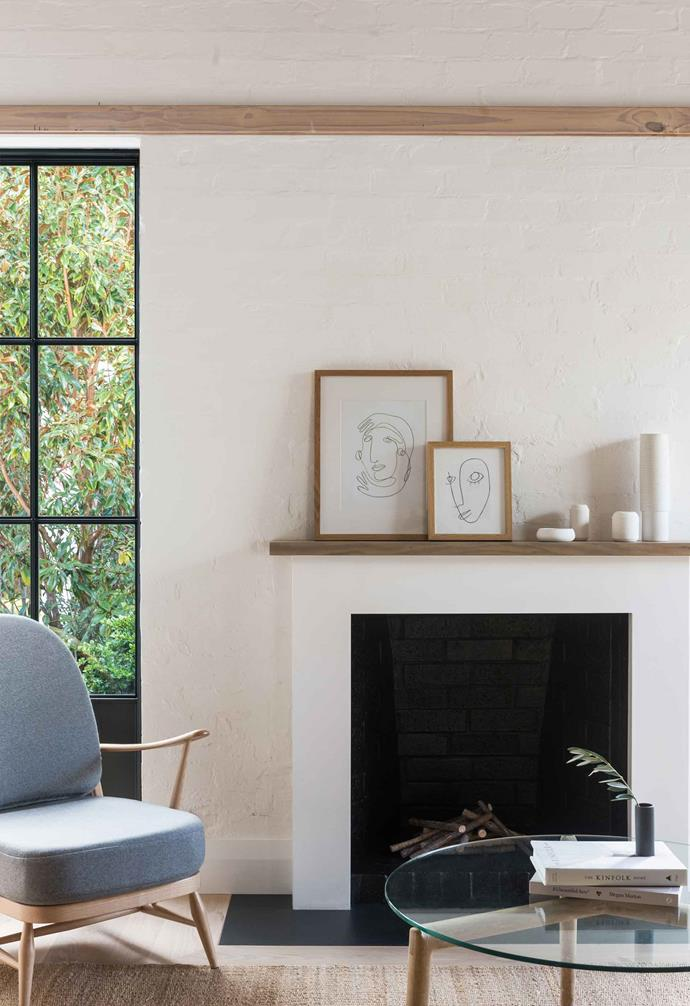 **Living area** The custom black-framed steel windows are a bold recurring element throughout the home.