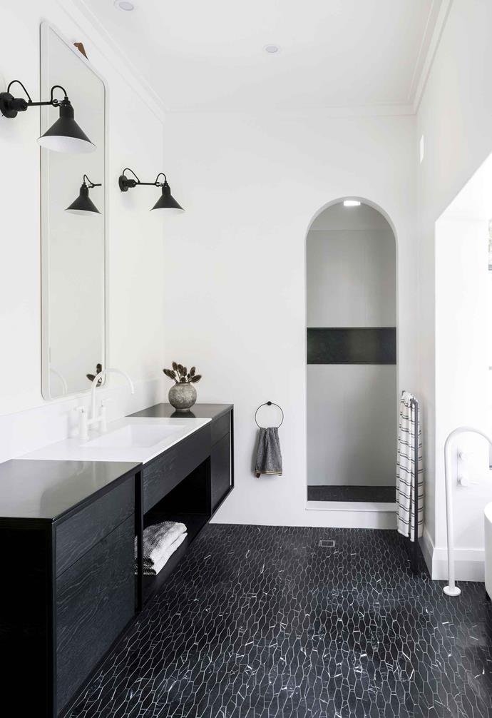 "**Ensuite** Sue's sanctuary also includes a generous rain shower, entered via the arched opening. Corian vanity. Towel, [Empire Homewares](https://empirehomewares.com.au/|target=""_blank""