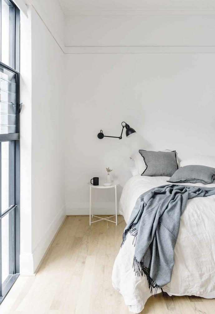 """**Georgia's bedroom** The metal reading lamp coordinates with the metal doors. Side table, [IKEA](https://www.ikea.com/ target=""""_blank"""" rel=""""nofollow""""). DCW Editions 'Gras' wall lamps, [Spence & Lyda](https://www.spenceandlyda.com.au/ target=""""_blank"""" rel=""""nofollow""""). Linen and cushions, [Asbury Park Agency](http://www.asburyparkagency.com.au/ target=""""_blank"""" rel=""""nofollow"""")."""