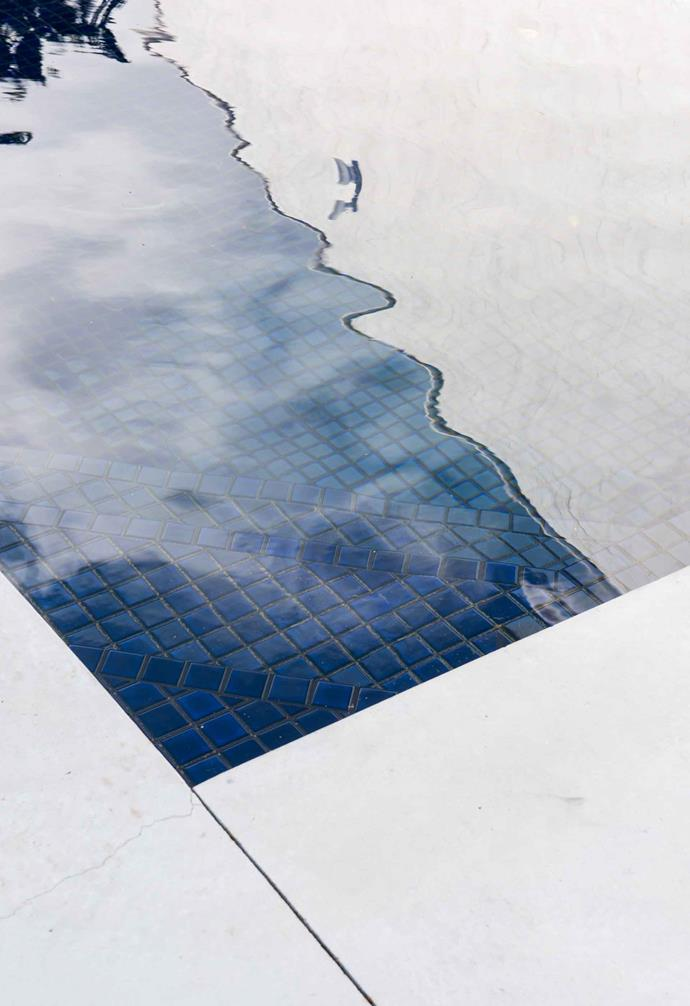 """**Pool** """"It used to have a turquoise border,"""" says Sue. """"We relined it with a navy tile that changes colour with the angle of the sun."""""""