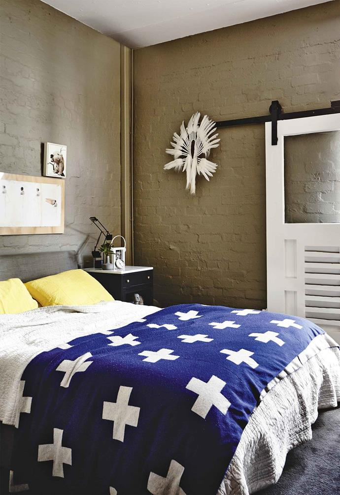 "This [converted warehouse home in Melbourne](https://www.homestolove.com.au/warehouse-living-cool-melbourne-style-18326|target=""_blank"") pairs moody tones with vintage pieces to create a playful industrial chic abode. This sliding barn door was an original element of this home before the renovation."