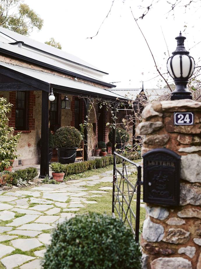 A little box hedge and potted topiary alongside the slate paving frequently found in the Adelaide Hills.