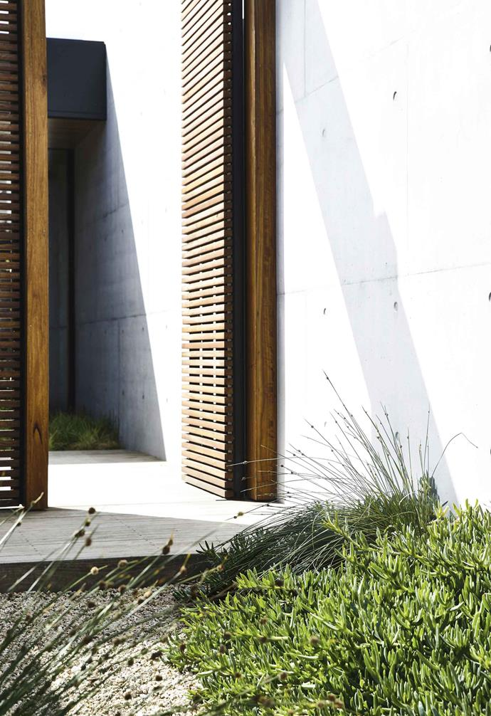 "**Batten down – or across** On-trend slim slats guarantee privacy and contrast with the concrete of this [Mornington Peninsula home](https://www.homestolove.com.au/coastal-native-garden-18599|target=""_blank"") by [Planned Living Architects](https://www.plannedlivingarchitects.com.au/