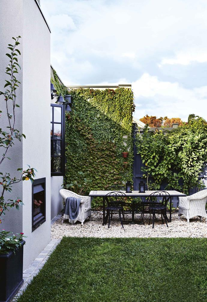 """We just fell in love with Melbourne again,"" explains fashion designer Angela. ""And after moving in, we realised how amazing the house is, especially where it's situated, and quickly decided we weren't going anywhere. We'd spent 10 years living overseas – first in London and then Luxembourg – and were sick of moving around.""<br><br>**Courtyard** Owner Angela and her family lost a large chunk of their garden with the latest extension, but she says the courtyard works perfectly now the children are older. An outdoor fire turns this alfresco space into a cosy zone in winter."