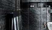 Black tiles bring drama to this modern bathroom