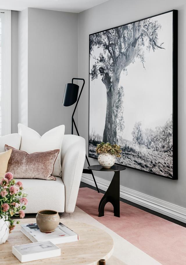 "With the colour palette dialled to neutral and a less formal aesthetic, this [Sydney house](https://www.homestolove.com.au/functional-and-elegant-home-by-arent-and-pyke-20352|target=""_blank"") has a new lease on life courtesy of Arent & Pyke. In the living room is a *Eucalyptus Camaldulensis 9* artwork by Chris Langlois. From *Belle* June/July 2019."