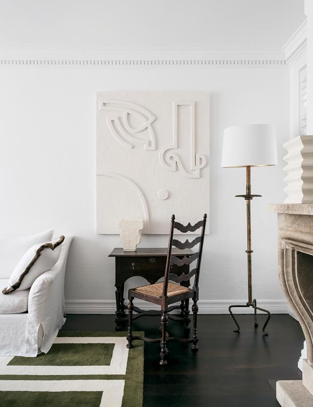 "A deft blend of custom-made, contemporary and antique pieces creates a unique ambience in this [classic Sydney home](https://www.homestolove.com.au/a-classic-sydney-home-decorated-with-contemporary-and-antique-pieces-20209|target=""_blank"") designed by interior architect and designer Phoebe Nicol. In the living room, an artwork by Angie Pai is perfectly in keeping with the neutral palette. From *Belle* May 2019."