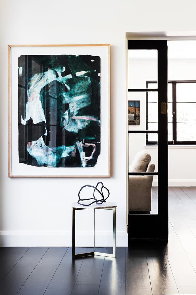 "It took a while for the owner to fall for this [Spanish Mission home](https://www.homestolove.com.au/spanish-mission-home-in-sydney-6324|target=""_blank"") but now, with an Arent & Pyke revamp, it's a dream come true. In the entryway is an artwork by Antonia Mrljak and a sculpture from Basic Curate. Architecture by Luke Moloney Architecture. From *Belle* February/March 2018."