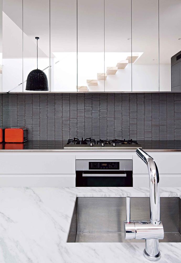 "**Mirrored cupboards** While [splashbacks](https://www.homestolove.com.au/kitchen-splashback-ideas-17258|target=""_blank"") are often the go-to use of mirrors in the kitchen, a hit of reflective glass brings a dynamic look to cabinetry. <br><br>Placing mirrored [cabinet doors](https://www.homestolove.com.au/kitchen-cabinet-colour-ideas-17864