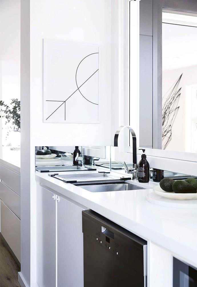 "**Mirror joinery detail** Think outside the square and add a mirror to an unlikely spot for an element of surprise. <br><br>The sleek and seamless joinery of the kitchen in this [minimalist monochrome apartment](https://www.homestolove.com.au/minimalist-apartment-northern-beaches-17911|target=""_blank"") gets a practical lift from a mirror in a spare nook. <br><br>The mirror also creates a focal point that draws the eye away from the sink and prep zones. <br><br>This application is also great for those who want the look of the mirrored splashback, with less maintenance required. <br><br>Adding a mirrored kickboard to the base of kitchen cabinetry is another way to make an impact in an often overlooked area.<br><br>"