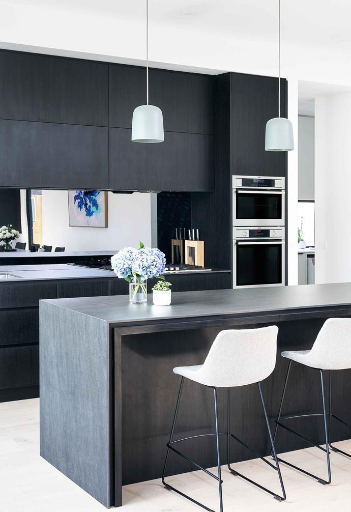 "**Mirror splashback**<br><br>A sleek mirror splashback is often chosen to suit [contemporary kitchen designs](https://www.homestolove.com.au/modern-kitchen-ideas-18756|target=""_blank"") like the chic one in this [renovated century-old Elstenwick home](https://www.homestolove.com.au/century-old-home-renovation-elstenwick-19556