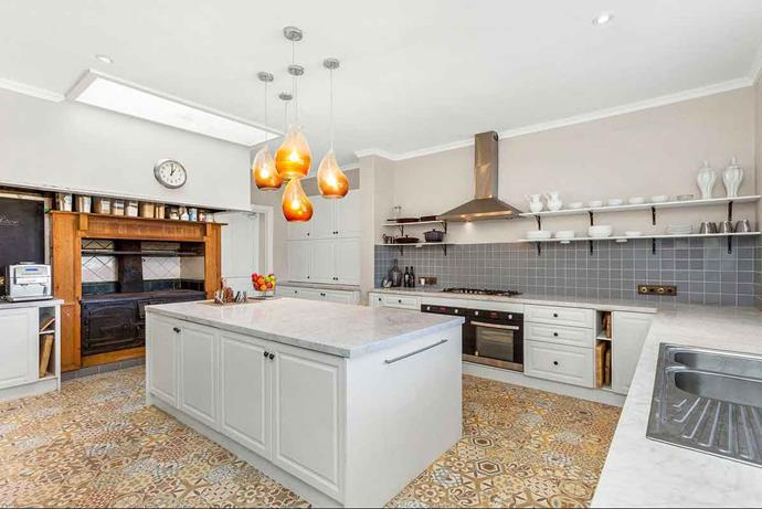 Shaynna Blaze and her team completely revamped the kitchen, adding a centre island, patterned floor tiles and modern appliances.