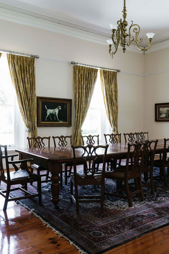 The dining room furniture belonged to the Russell family and the painting is by British artist John Gray.