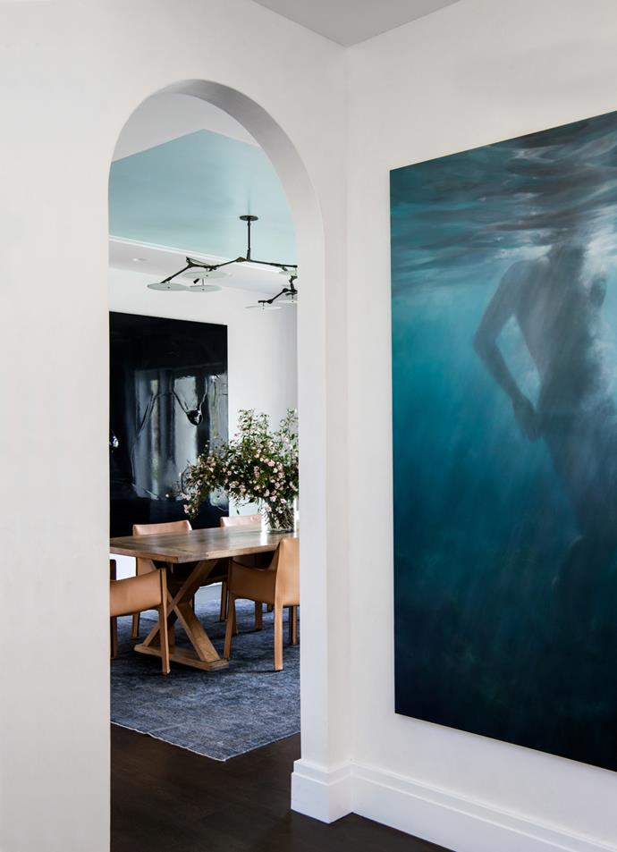 "Enhancing and maintaining the existing design features of this [Mediterranean-inspired house](https://www.homestolove.com.au/mediterranean-inspired-sydney-harbour-house-5723|target=""_blank"") was key to its metamorphosis. In the dining froom and hallway are artworks by Dale Frank (left) and Martine Emdur (right). Designed by Robert Weir, Giuseppe Alvaro and Briony Fitzgerald. From *Belle* August/September 2017."