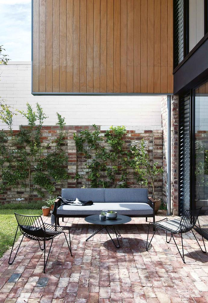 "The resulting masterpiece was recognised at the 2015 WA Architecture Awards in the Residential Architecture – New Houses category, and was short-listed in the 2015 Houses Awards.<br><br>**Backyard** The recycled brick was salvaged from a cottage in Maylands that was being demolished. Plywood cladding and aluminium window frames are a budget-friendly choice. Table and chairs, [Massproductions](https://massproductions.se/|target=""_blank""