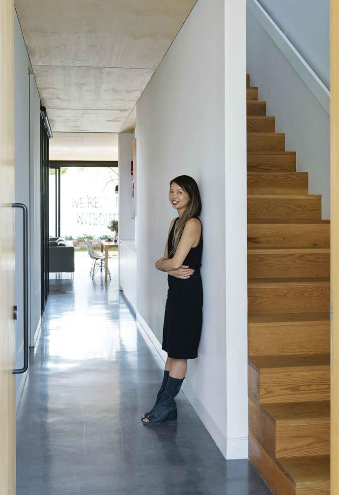 "When it came to choosing a location for their new build, Yun Nie and Patrick prioritised location over block size. ""We chose Fremantle as it's close to the coast, urban and rich in character,"" says Yun Nie. ""We wanted to design a house that was modern and contemporary but did not feel 'new': a place that had instant character."" <br><br>In order to comfortably cater to the family's needs, the final design had to include two bedrooms with the possibility of expanding to three, a spare room that could be a study, a guest room, TV room or family room, and somewhere for the kids to play.<br><br>**Hallway** Homeowner and architect Yun Nie Chong stands in the hallway."
