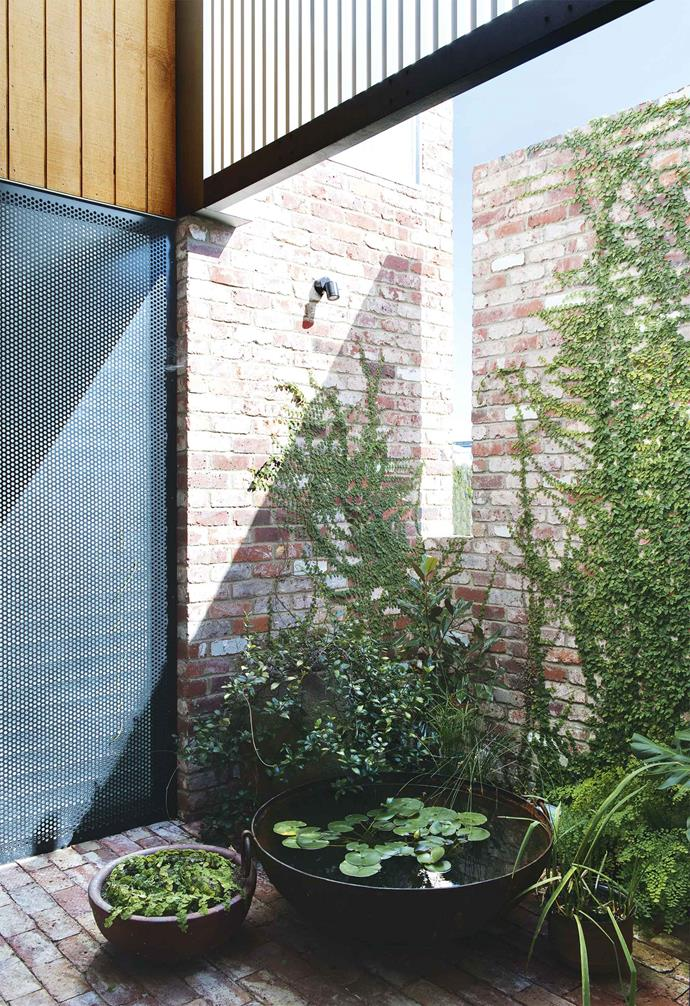 "Like the [home's exterior](https://www.homestolove.com.au/home-exterior-materials-14909|target=""_blank""), the interior is robust and industrial, but also features touches of luxury, such as Carrara marble [benchtops](https://www.homestolove.com.au/kitchen-benchtop-guide-19237