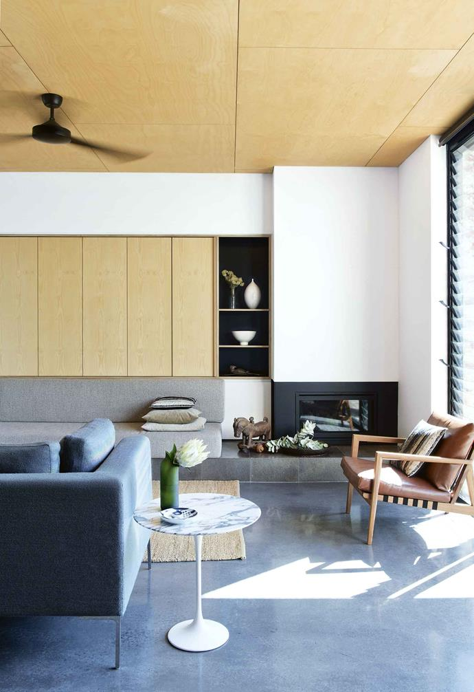 "The couple's choice of furniture is a mix of modern pieces, including the B&B Italia sofa, and items from [Australian designers](https://www.homestolove.com.au/australian-creatives-20362|target=""_blank""), such as the kitchen's 'Thimble' stools, designed by Dowel Jones, and the Tait outdoor sofa. Bespoke items, such as the custom cabinetry built by Dave Eastwood from Raw Edge Furniture, and the dining table – a design collaboration between Yun Nie, Patrick and Ben Savage from Squarepeg Home – were sourced from local artisans.<br><br>**Living area**To maximise the usable space, Yun Nie and Patrick didn't hold back when it came to spending on joinery. The built-in cabinetry offers storage and conceals the TV, while a custom bench seat below is a smart choice in a small space. A woven Armadillo & Co rug and leather 'Blava' easy chair by Ritzwell add extra warmth to the modern space. 'Tulip' Side table by Eero Saarinen, [Knoll](https://knoll.com/