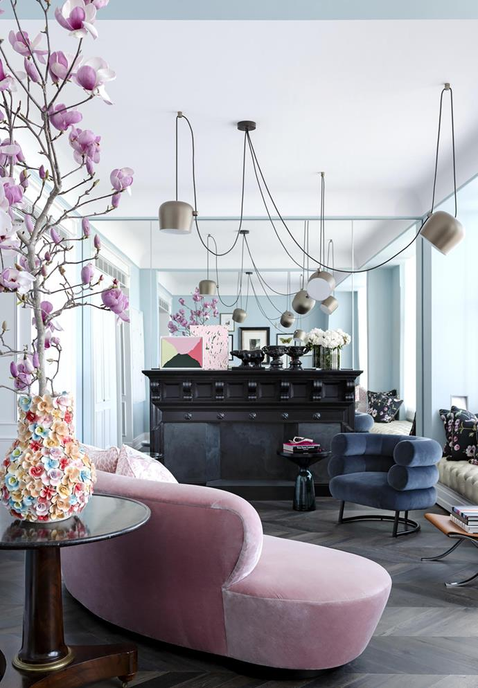 Vase from Janus et Cie. Sofa by Vladimir Kagan in Rubelli pink velvet. ClassiCon 'Bibendum' chair by Eileen Gray from Anibou. Knoll 'Barcelona' sling ottoman from De De Ce. Artworks by Andreas Reiter Raabe (front) and Gemma Smith (rear) from Sarah Cottier Gallery.