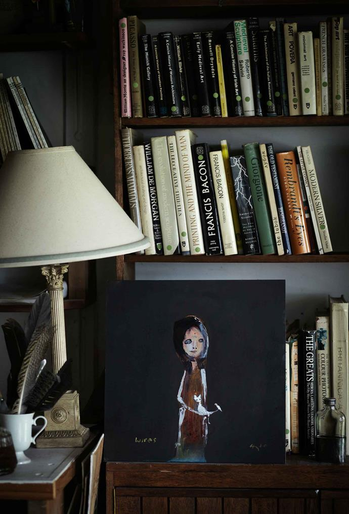 Art books in the library and a mixed media piece by Greg Hyde called Girl In WIRES. Salvaged antique fixtures and furnitures fill the home with 'heart'.
