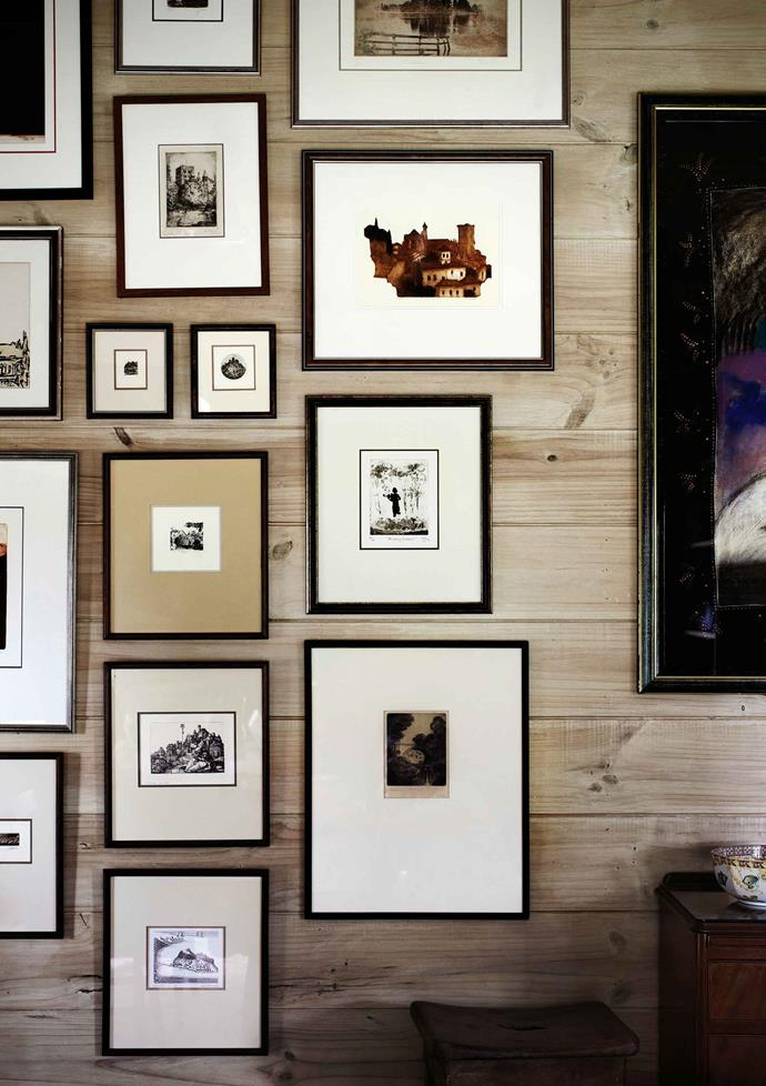 "Etchings gathered on European travels make up the [gallery wall](https://www.homestolove.com.au/how-to-create-an-art-gallery-wall-4860|target=""_blank"") in the home's entrance hallway."