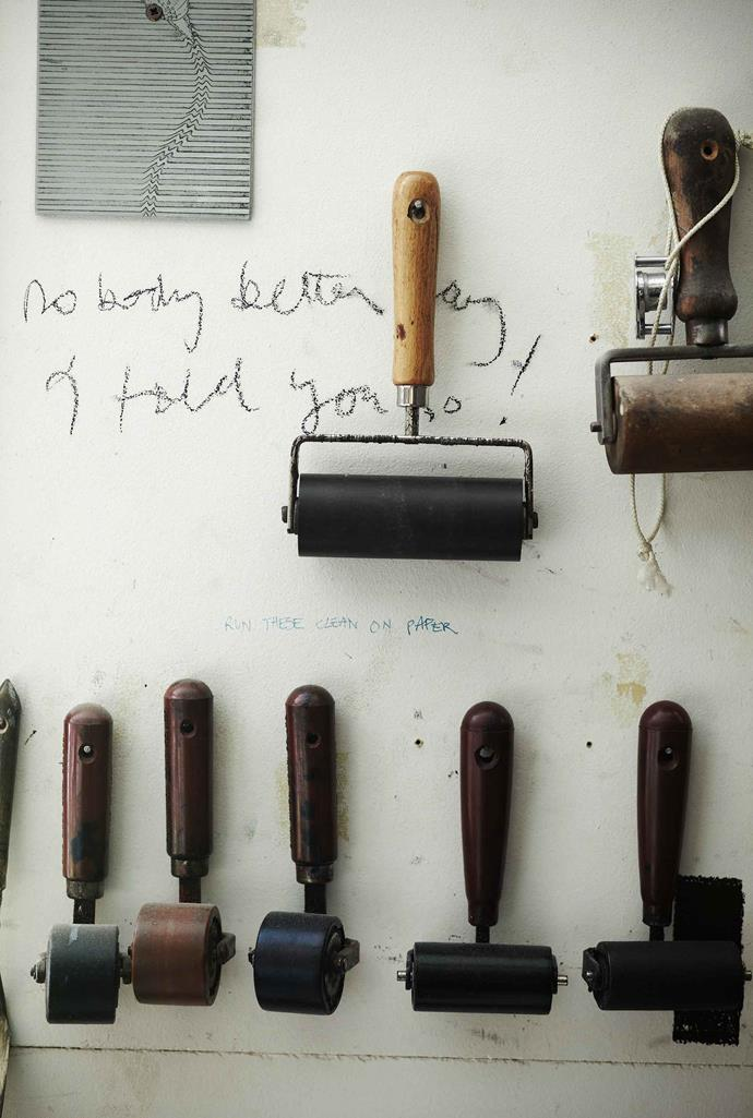 The rollers used for Greg's etchings. He often scribbles lines from plays and books on his studio wall for inspiration.