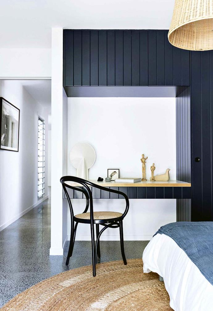 "In this [serene beach house](https://www.homestolove.com.au/macmasters-beach-house-18226|target=""_blank"") the architect created an extension of the panelled black wardrobe in one of the bedrooms which functions as a makeshift home office when needed. By echoing the paint colour and panelled look of the wardrobe, the [study nook](https://www.homestolove.com.au/12-creative-ways-to-create-a-study-nook-in-your-home-17963
