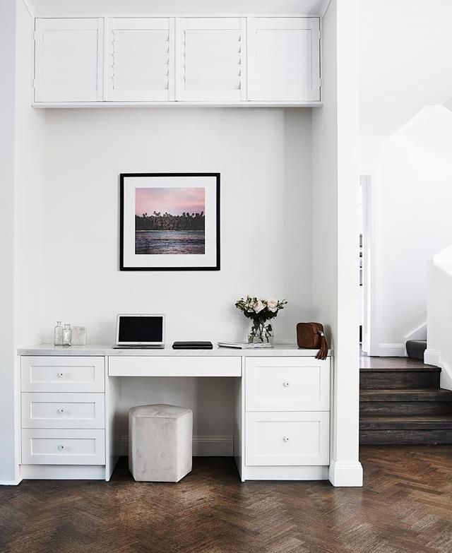 "A white colour palette ensures the home study in this [Federation home](https://www.homestolove.com.au/federation-home-receives-modern-revamp-19693|target=""_blank"") fits seamlessly into the surroundings. Above the desk is an aircon unit cleverly hidden by louvres."