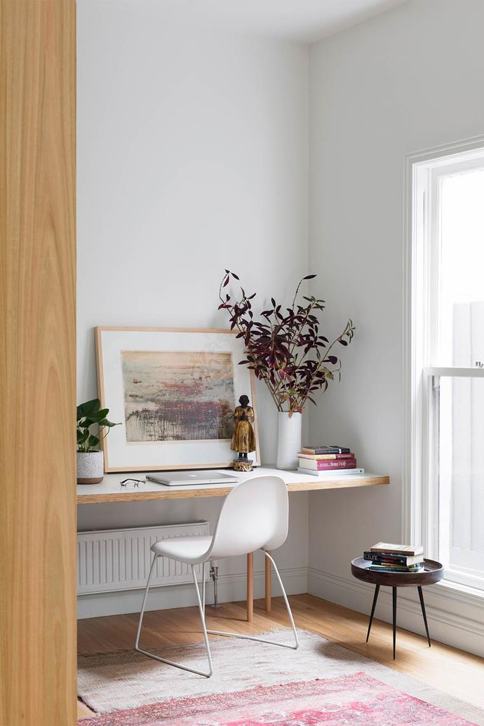 "Natural light pours into this [chic study](https://www.homestolove.com.au/bespoke-renovation-of-an-old-victorian-terrace-4456|target=""_blank""), painted in Dulux Whisper White. A custom-made bookshelf designed by FMD Architects provides a display case for the owner's collectables."