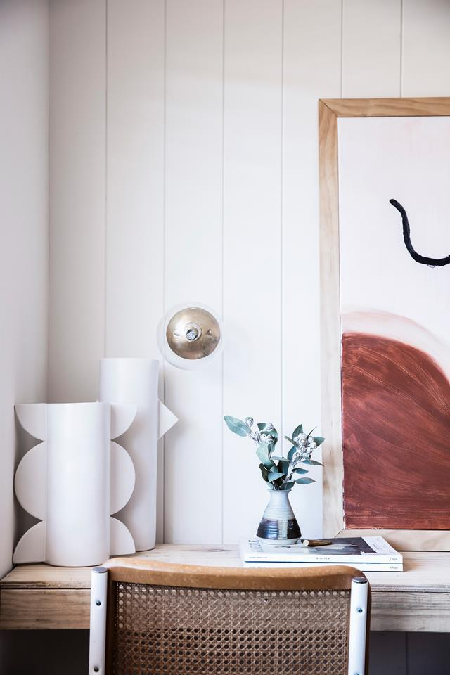 "The pretty home office of this [renovated Sydney apartment](https://www.homestolove.com.au/coastal-apartment-renovation-19053|target=""_blank"") is filled with an elegant array of artworks and ceramic sculptures that inspire the homeowners' work."