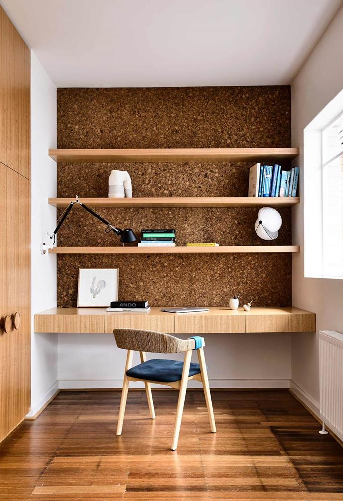 "The thickness of the desk in this [modernist red brick home](https://www.homestolove.com.au/modernist-red-brick-home-17821|target=""_blank"") conceals drawers and tall cabinetry to the side allows for extra household storage. The cork feature wall adds dynamic depth to this home office, and also allows for the pinning of notes and papers when needed."