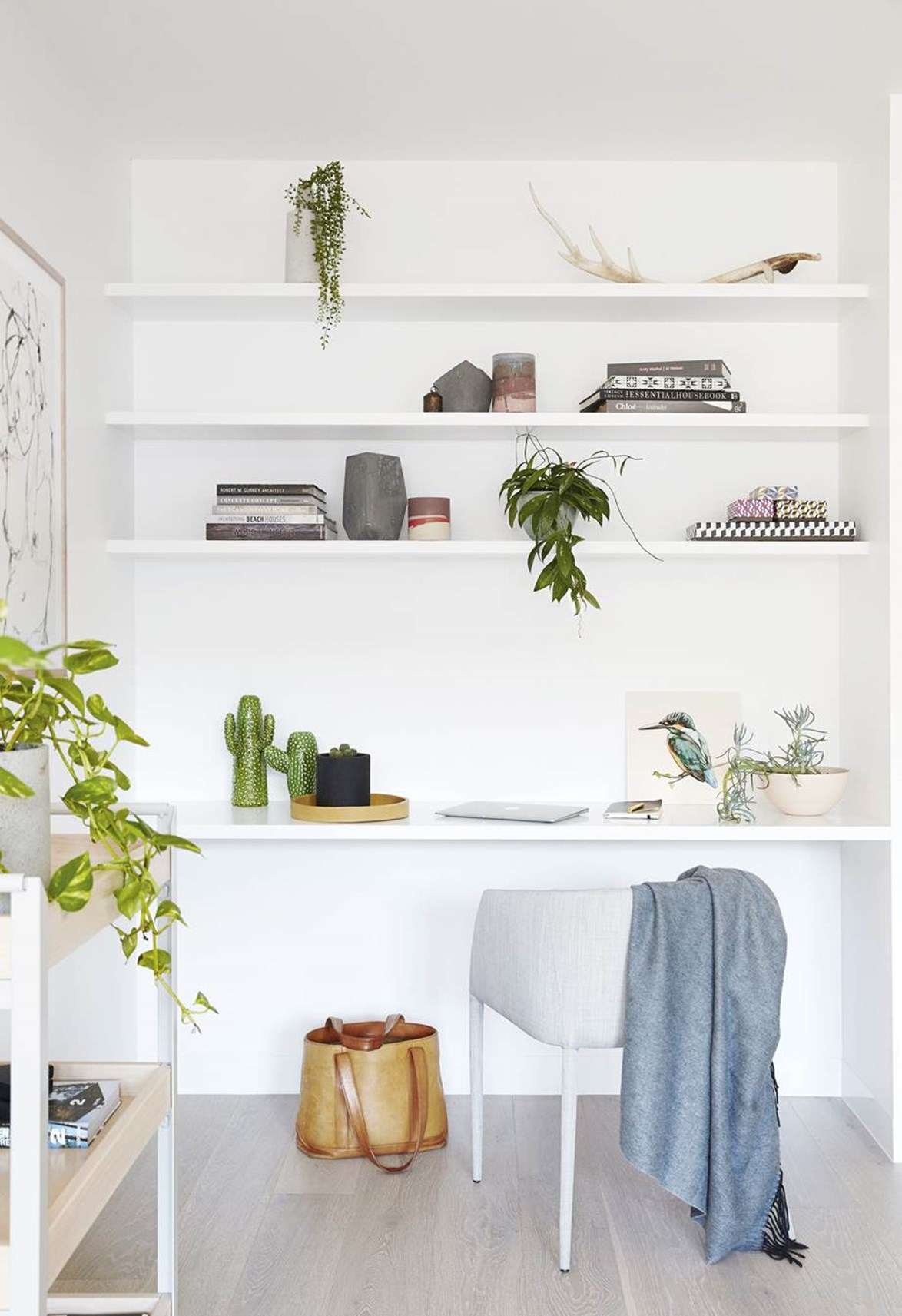 Indoor plants bring this simple office space to life.