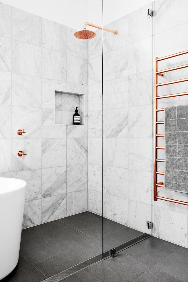 "Gleaming copper shines bright and warm in this elegant [marble bathroom](https://www.homestolove.com.au/a-luxe-copper-and-marble-bathroom-4680|target=""_blank"")."