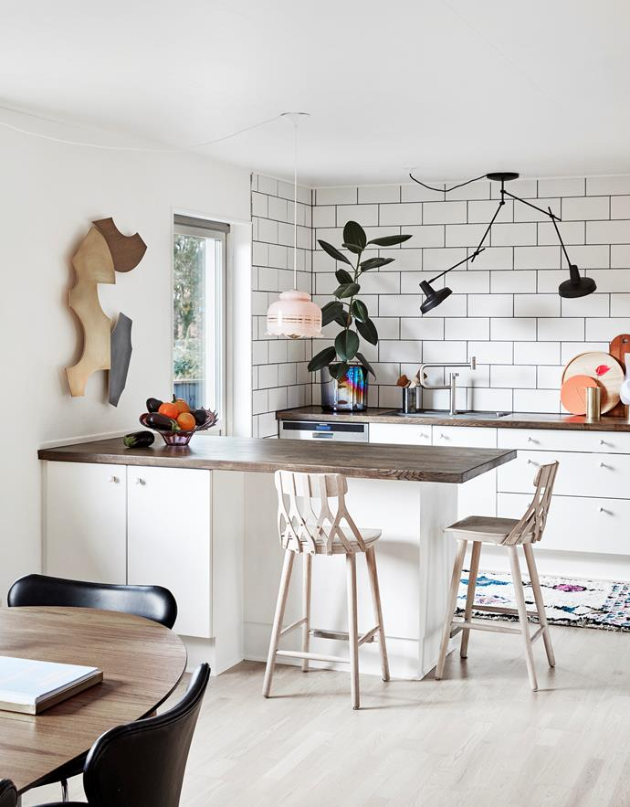 "The couple made small tweaks to the kitchen without altering its basic structure: ""We put up new metro tiles on the wall, an eco-friendly, FSC-certified oak worktop from Horn and changed the handles on the cabinets."""