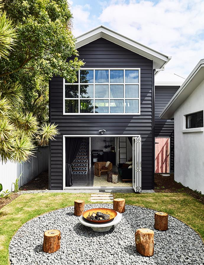 Simple, yet effective, this outdoor fire pit creates a central zone for entertaining in winter and increases the value of this small backyard. *Image: Toby Scott / bauersyndication.com.au*