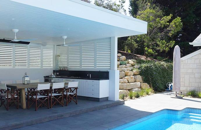 """This beautiful outdoor kitchen with poolside views is perfect for entertaining and provides plenty of shade and protection in te harsh summer months. *Image: supplied / [Victory Blinds](https://www.victoryblinds.com.au/ target=""""_blank"""" rel=""""nofollow"""")"""