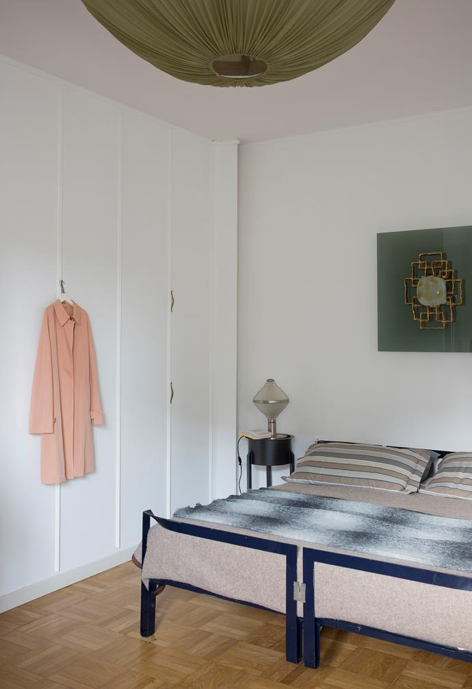 The bedroom is somewhat pared back compared to the rest of the house. The Vanessa bed by Tobia Scarpa takes centre stage, while the wardrobe shutters designed by Osvaldo Borsani cover one wall almost entirely.