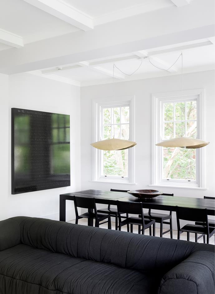 'Fold' table from Boffi . Gervasoni pendant lights from Anibou. Artwork by Shane Pennington.