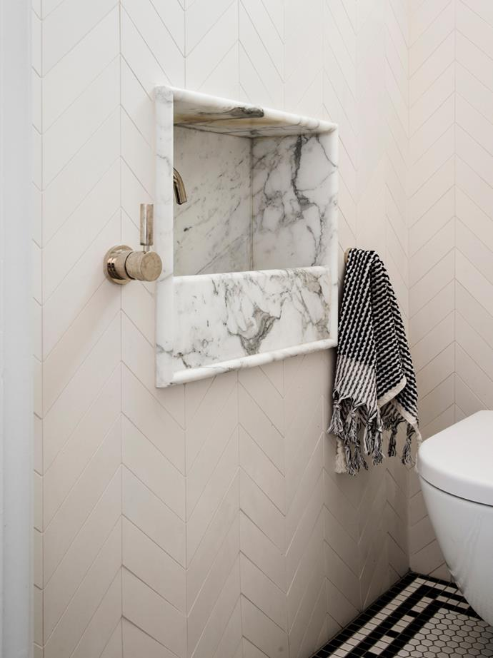 'Mutina Mews' tiles from Academy Tiles laid in a chevron pattern in the bathroom. Astra Walker tapware.