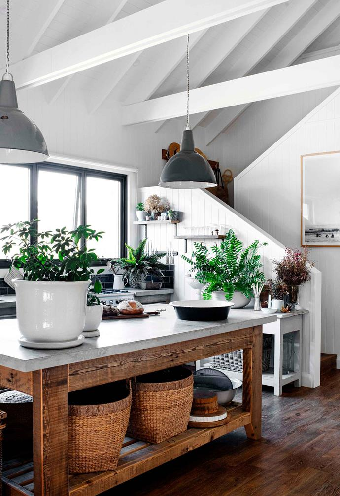 "Making the most of high ceilings, this [modern barn-style home](https://www.homestolove.com.au/modern-barn-style-house-19961|target=""_blank"") features exposed ceiling beams that are painted a stark white to match the white palette of the rest of the home. Industrial-style pendant lights sing in this kitchen space."