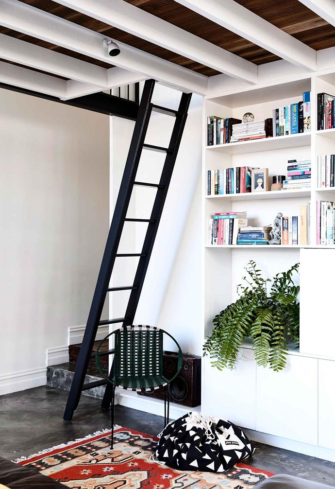 "The ceiling in the reading nook of this [inner-city Edwardian home](https://www.homestolove.com.au/inner-city-renovation-advice-6704|target=""_blank"") features dark timber paired with white exposed ceiling beams that add warmth to the concrete and white space. Juxtaposing ceiling colours with that of your exposed beams can create a dynamic contrast."