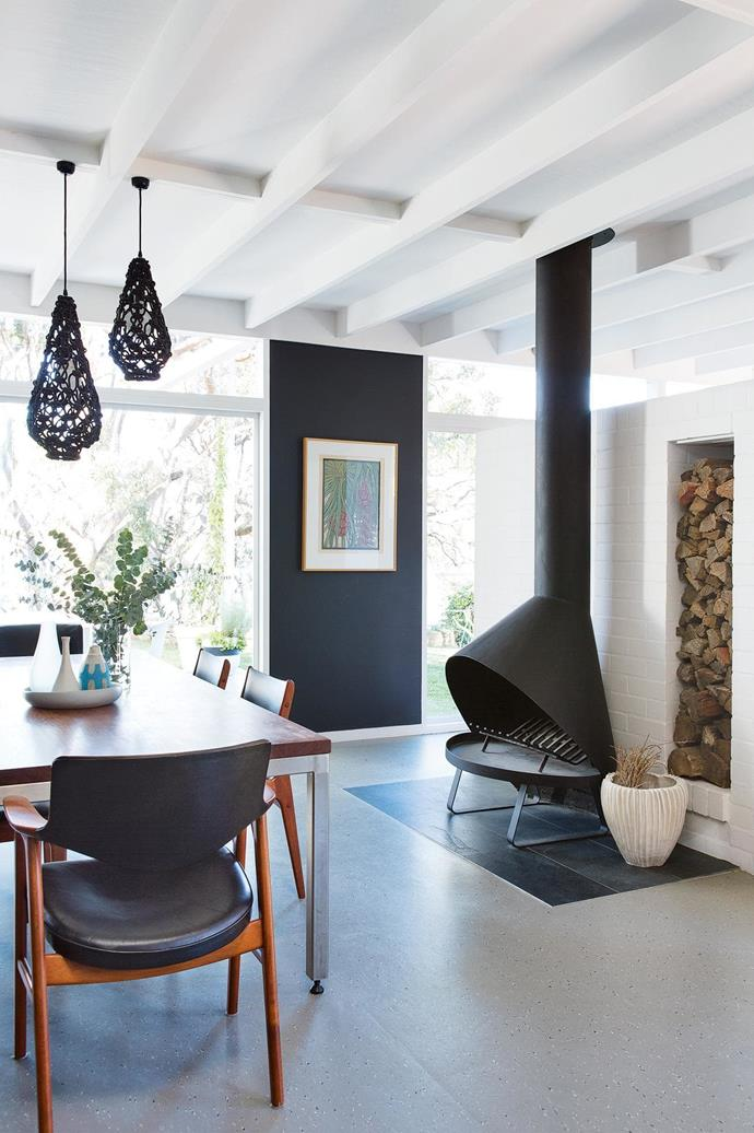 "The exposed ceiling beams in this [modernist-style family home](https://www.homestolove.com.au/step-inside-this-colourful-and-practical-family-home-17570|target=""_blank"") add a timeless look when paired with polished concrete floors and exposed brick in this dining room space."