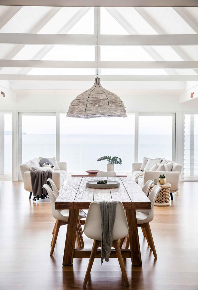 "This [renovated beach house](https://www.homestolove.com.au/beach-house-renovation-19763|target=""_blank"") features a pitched cathedral ceiling with white exposed ceiling beams. The white beams enhances the natural light that enters this open-plan living and dining space while creating a relaxed coastal atmosphere."
