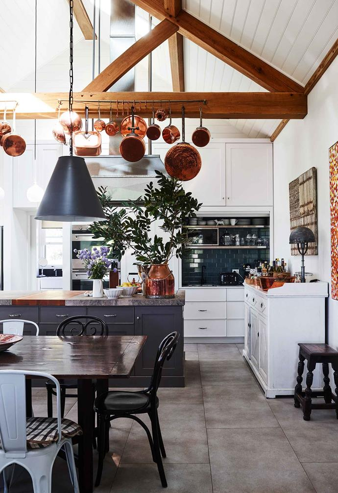 "This [Terragong Bed and Breakfast](https://www.homestolove.com.au/terragong-b-and-b-nsw-south-coast-19341|target=""_blank"") has transformed their exposed ceiling beams into both a visual and practical feature, with the cross beams also acting as a makeshift display and storage unit for kitchen pots and pans."